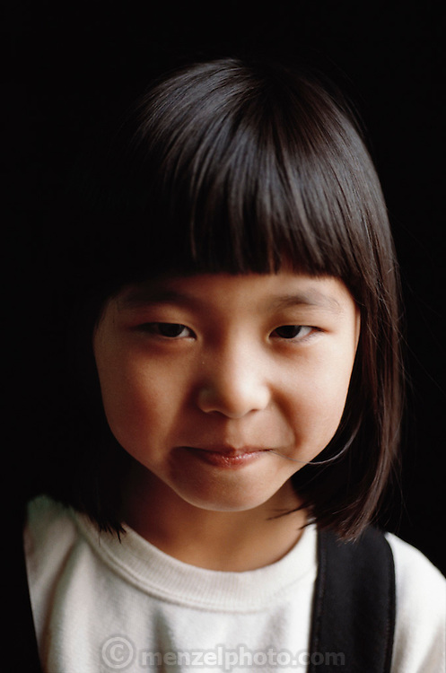 Portrait of Maya Ukita, 6. Kodaira City, Japan. Material World Project. The Ukita family lives in a 1421 square foot wooden frame house in a suburb northwest of Tokyo called Kodaira City.