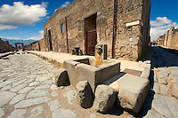 Well in the street of Pompeii archaeological site.
