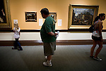 Guests view paintings in the Crocker Art Museum in Sacramento, California.