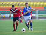 St Johnstone v FC Minsk...01.08.13 Europa League Qualifier at Neman Stadium, Grodno, Belarus...<br /> David Wotherspoon and Dmitry Gorbushin<br /> Picture by Graeme Hart.<br /> Copyright Perthshire Picture Agency<br /> Tel: 01738 623350  Mobile: 07990 594431