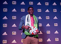 #8 overall pick Damian Lowe of the Seattle Sounders stands on the podium during the MLS SuperDraft at the Pennsylvania Convention Center in Philadelphia, PA, on January 16, 2014.