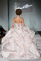 Model walks the runway in a Tika wedding dress by Katerina Bocci during the Wedding Trendspot Spring 2011 Press Fashion, October 17, 2010.