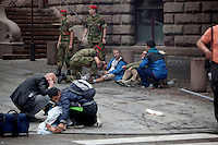 Oslo Norway 20110722 -  Terror attack on the government quarters in Oslo and AUF youth camp at Utoya / Ut&oslash;ya.  Pictured: injured people in the street Akersgata getting treatment from bypassers and military personell, 15 minutes after the attack. Photo/copyright: Torbjorn Gronning.