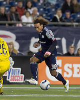 New England Revolution defender Kevin Alston (30) passes the ball.  In a Major League Soccer (MLS) match, the Columbus Crew defeated the New England Revolution, 3-0, at Gillette Stadium on October 15, 2011.