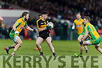 Tony Brosnan Dr. Crokes in action against Michael Lundy Corofin in the Semi Final of the Senior Football Club Championship at the Gaelic Grounds, Limerick on Saturday.