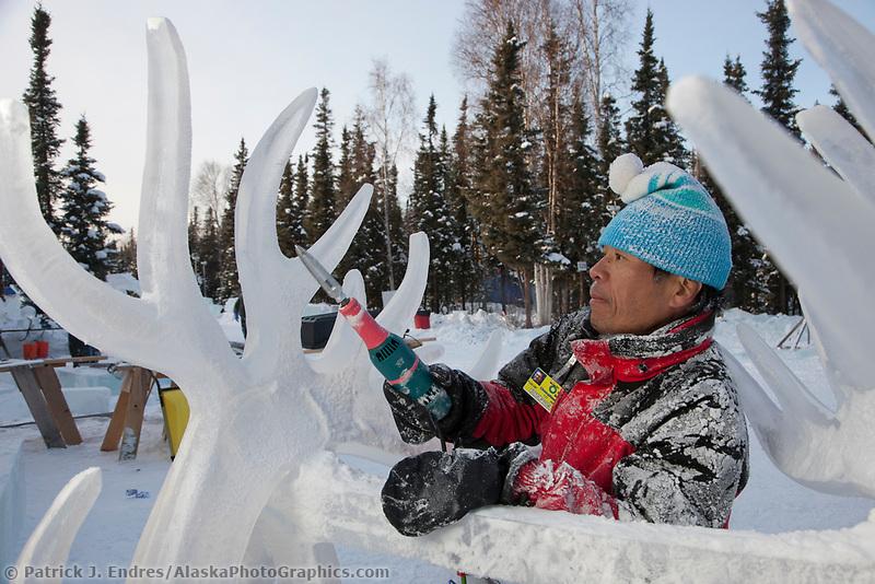 "Fukumi Furukawa, Japan, works on the antlers of a caribou for the multi block sculpture titled ""White Fang"" for the 2009 World Ice Art Championships in Fairbanks, Alaska. Team members: Junichi Nakamura, Shinichi Sawamura, Fukumi Furukawa, Takao Waki."