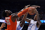 26 January 2015: Syracuse's Rakeem Christmas (25) challenges for the ball with North Carolina's Isaiah Hicks (22) and Joel James (center). The University of North Carolina Tar Heels played the Syracuse University Orange in an NCAA Division I Men's basketball game at the Dean E. Smith Center in Chapel Hill, North Carolina. UNC won the game 93-83.