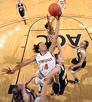 Dec. 18, 2010; Charlottesville, VA, USA; Virginia Cavaliers center Simone Egwu (4) grabs the rebound next to UMBC Retrievers 6-0 Meghan Colabella forward (10) during the game at the John Paul Jones Arena. Virginia won 61-46. Mandatory Credit: Andrew Shurtleff