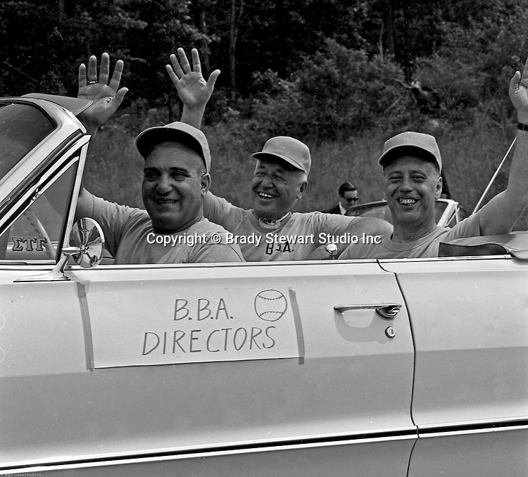 Bethel Park PA:  BBA Directors riding in a car during the annual parade for the Bethel Baseball Association - 1964.  The BBA was very successful in teaching the young boys how to play baseball the right way.  The proof was that Bethel Park High School Baseball teams were some of the most successful in WPIAL history.  In the car; Chet Lucido, and Nick Smergin