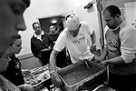 Dinner service at City Team Ministries, where local church groups often volunteer to serve meals and lead the evening prayer, which clients are required to attend to spend the night.