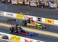 Sep 18, 2016; Concord, NC, USA; NHRA top fuel driver Pat Dakin (near) races alongside J.R. Todd during the Carolina Nationals at zMax Dragway. Mandatory Credit: Mark J. Rebilas-USA TODAY Sports