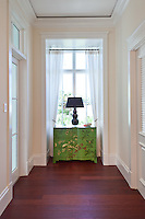The bright green hand painted chest adds an unexpected pop of color and pattern to create a unique focal point.