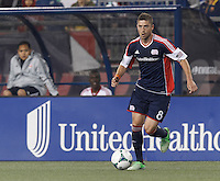 New England Revolution defender Chris Tierney (8) on the attack. In a Major League Soccer (MLS) match, the New England Revolution (blue) tied New York Red Bulls (white), 1-1, at Gillette Stadium on May 11, 2013.