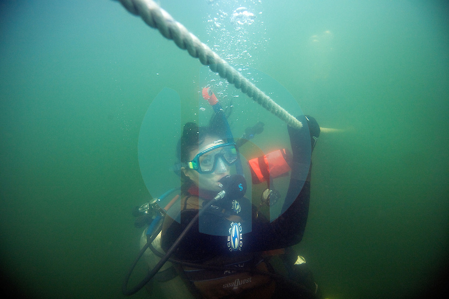 "20080720_HONG KONG_ A diver descends to the depths using and anchor line, while diving the ""Trio Islands"" in Hong Kong's Sai Kung District.  The divers are part of a British Sub Aqua Club or BSAC dive expidition.  Photographer: Daniel J. Groshong/Tayo Photo Group"