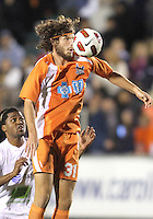 Tom Heinemann #31 Of the Carolina Railhawks leaps over Alexis Rivera #6 of the Puerto Rico Islanders during the second leg of the USSF-D2 championship match at WakeMed Soccer Park, in Cary, North Carolina on October 30 2010. The game ended 1-1, Puerto Rico won on overall goals 3-1.