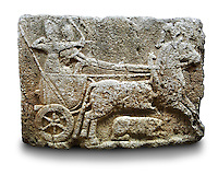 Picture & image of a Neo-Hittite orthostat with a chariot Releif sculpture from Karkamis,, Turkey. Ancora Archaeological Museum. The Cahiot is pulled by horses with plumed headresses. One man os about to shoot an arrow from his bow, the other man is driving the cahriot. Below the horse is a animal cowering. 5