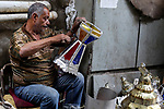 """An Egyptian worker manufactures a traditional Lantern known as """"Fanous"""" in Arabic at ahead of the Muslim holy month of Ramadan in Cairo, Egypt, on May 21, 2017. Photo by Amr Sayed"""