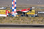 Bill 'Tiger' Destafani gets airborne in the P-51D Mustang 'Strega' for the Gold Championship Race at the 2008 Reno National Championship Air Races held annually at Stead Field, Nevada.  Strega, a modified North American Aviation P-51D Mustang powered by a Rolls Royce Merlin engine, finished 1st for the seventh time in its illustrious career.