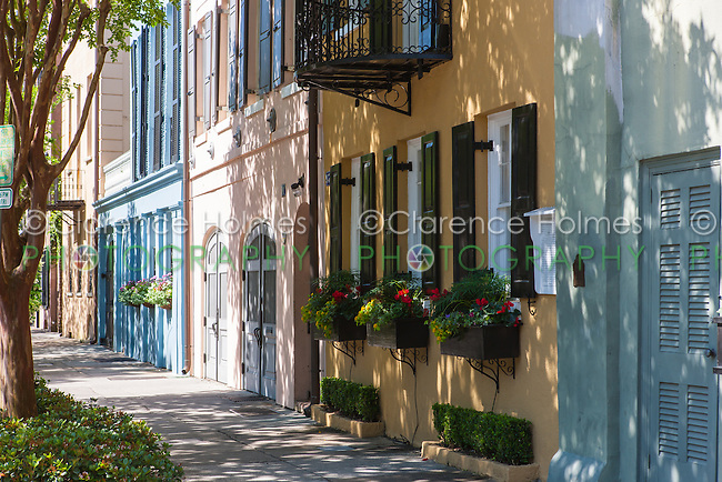 Colorful row houses line Rainbow Row in Charleston, South Carolina.