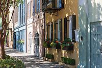 Colorful row houses line Rainbow Row in Charleston, South Carolina.