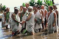 Mau Piailug and Myron Pinky Thompson greet each other as voyaging crew of Hokule'a arrive at Taputapuatea Marae, Raiatea, Tahiti _ 1995