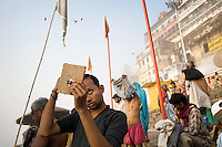 Hindu pilgrims gather at the banks of the Ganges river at the holy city of Varanasi, also known as Benares.<br />