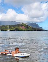 A two-year-old boy on boogie board in Hanalei Bay, Kaua'i.