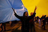 """Kiev, Ukraine.December 28, 2004..A pro-Viktor Yushchenko rally in Kiev under the Ukrainian flag, as election polls show Yushchenko the clear winner. He has not yet been declared the President nor has his opponent refuses to admit defeat. ..The first round of voting was considered fraudulent when the ruling president Viktor Yahukovich won and the opposition candidate Viktor Yushchenko lost. ..Several hundred thousand Ukrainians took to the streets of Kiev and held daily rallies on Maidan Independence Square. The protests lasted nearly a month before the first vote was declared invalid and a new round of elections held on December 26, 2004. ..The demonstrations would come to be known as the """"Orange Revolution"""" after the color of the opposition party."""