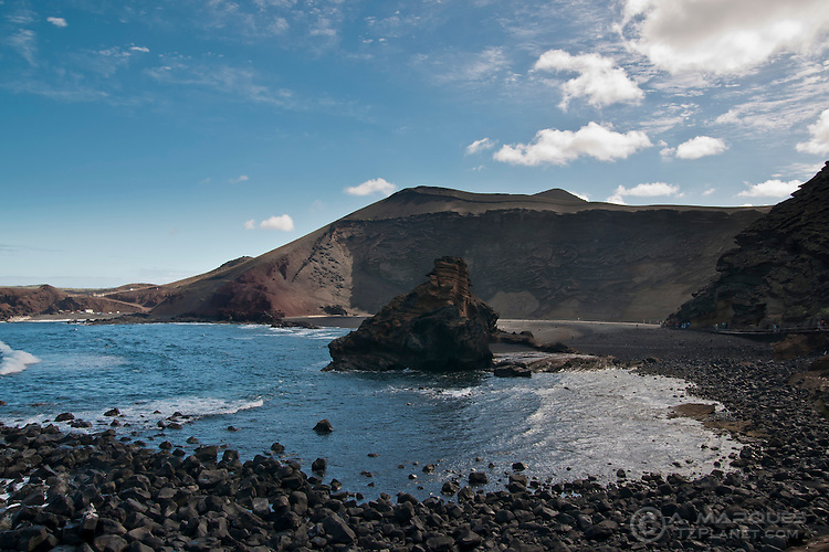 El Golfo is a half volcano crater on the Island of Lanzarote, canary Islands, Spain. The crater, formed in the 1730s eruptions, as since been eroded by the sea and is now half submerged by the incoming tide.