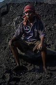 Mohan Bhujian, a daily wage labourer poses for a portrait in Goladi coal depot in Jharia, outside of Dhanbad in Jharkhand, India.  Photo: Sanjit Das/Panos