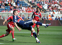 New York forward Kenny Cooper (33) performs a bicycle kick.  The Chicago Fire defeated the New York Red Bulls 3-1 at Toyota Park in Bridgeview, IL on June 17, 2012.