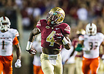 Dalvin Cook scampers 72 yards for a touchdown on his first carry in the first half of an NCAA college football game against Miami in Tallahassee, Fla., Saturday, Oct. 10, 2015.   The Florida State Seminoles defeated the Miami Hurricanes 29-24.