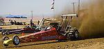 Top alcohol cars race at the National Sand Drad Race Association's 2009 Summer Nationals in Avenal, CA May 17, 2009.