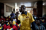 A man asks a question at  a conference for homosexuals and their supporters living in Kampala, Uganda. The meeting was the first attempt by the LGBT community in Uganda to unite people against a proposed anti-homosexuality bill in the countries parliment.