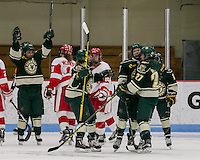 Boston, Massachusetts - February 27, 2016: NCAA Division I, Hockey East quarterfinals (best of three). University of Vermont (green) defeated Boston University (white), 4-2, at Walter Brown Arena. The win tied the best of three series. <br /> Goal celebration.