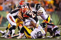 James Harrison #92 of the Pittsburgh Steelers tackles Giovani Bernard #25 of the Cincinnati Bengals during the Wild Card playoff game at Paul Brown Stadium on January 9, 2016 in Cincinnati, Ohio. (Photo by Jared Wickerham/DKPittsburghSports)