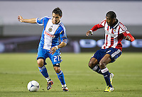 CARSON, CA - April 21, 2012: Philadelphia Union forward Michael Farfan (21) and Chivas USA midfielder Oswaldo Minda (8) during the Chivas USA vs Philadelphia Union match at the Home Depot Center in Carson, California. Final score Philadelphia Union 1, Chivas USA 0.