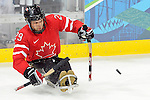 Graeme Murray (29) of Team Canada takes a shot during a sledge hockey game at the 2010 Paralympic Games in Vancouver.