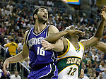 Sacramento Kings' Predrag Stojakovic of Serbia-Montenegro fights for rebound position with Seattle SuperSonics' Damien Wilkins in the  second period of their first round playoff game at Key Arena in Seattle, Washington Saturday, 23 April  2005.   Jim Bryant Photo. &copy;2010. All Rights Reserved.