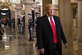 United States President-elect Donald Trump walks through the Crypt at the Capitol in Washington, Friday, Jan. 20, 2017, to his inauguration ceremony. Trump, a real estate mogul and reality television star who upended American politics and energized voters angry with Washington, will be sworn in as the 45th president of the United States, putting Republicans in control of the White House for the first time in eight years. <br /> Credit: J. Scott Applewhite / Pool via CNP