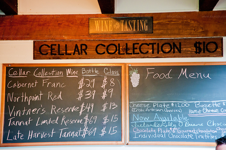 Black boards above the bar tell visitors what wines and snacks are available at the cellar collection tasting bar, Chateau O'Brien Winery and Vineyard.