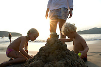 Federica and Eduardo play in the sand as Federico watches over them. photo shoot in Zihua with Federico Rigoletti and family, Diego Garcia and his daughters, and the Wiseman family as part of the Puntarena cook book