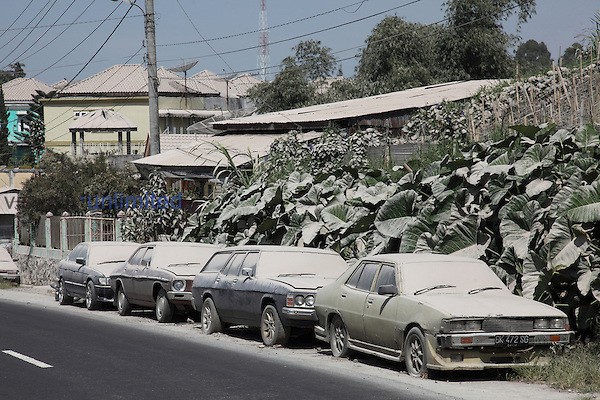 Ash coating on cars and buildings from eruption of Sinabung Volcano, Berstagi, Indonesia