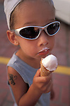 Boy in sunglasses eating ice cream