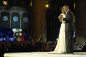 Washington, DC - January 20, 2009 -- United States President Barack Obama and first lady Michelle Obama dance during the Commander in Chief's Ball in downtown Washington, D.C., Tuesday, January 20, 2009.  More than 5,000 men and women in uniform are providing military ceremonial support to the presidential inauguration, a tradition dating back to George Washington's 1789 inauguration. .Credit: Kathrine McDowell - DoD via CNP.