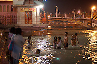 Immersing in the sacred waters of the Ganges at Haridwar