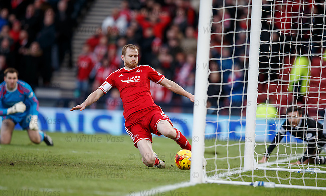 Ryan Dow dinks the ball past Aberdeen keeper Scott Brown and Mark Reynolds clears it off the line
