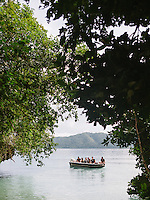 A speedboat full of tourist left the Gam Island, Raja Ampat, Indonesia, after the trek for the red bird of paradise (Cenderawasih Merah) birdwatching.