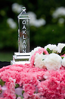 The Oaklawn Instant Racing trophy surrounded by flowers prior to the stakes race.