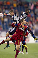 New England Revolution midfielder Chris Tierney (8), New England Revolution midfielder Sainey Nyassi (17), and Real Salt Lake midfielder Will Johnson (8) battle for head ball. Real Salt Lake defeated the New England Revolution, 2-1, at Gillette Stadium on October 2, 2010.